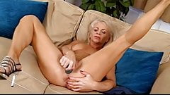 Stunning granny having fun with a dildo