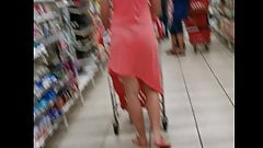Blonde white Milf in a pink transparent skirt and blue thong