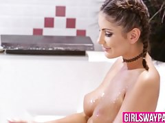 Good looking lesbians August and Cassidy have sex in bathtub