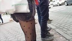 Sexy Slut in black patterned fishnet and mini skirt