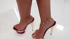 Hot girl showing her feet on high heels