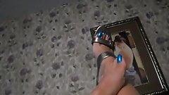 blue long toenails of a mature woman
