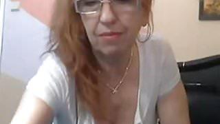 Naughty granny masturbates with dildo on cam