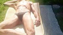 Mann sonnt sich ,Mann in String  geraman men sunning
