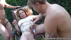 Mature lady sucks young cock while fingered outdoors