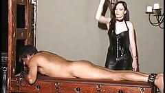 Leather milf femdom giving slave a bootjob