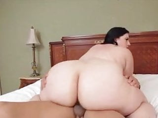 Thick brunette fucks passionately on the bed