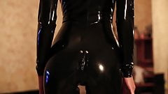 A latex girl ( black latex...thigh high pac boots)
