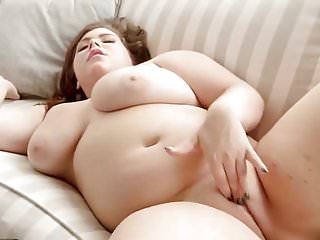 Chubby babe rubs her bald pussy