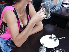 Woman at cafe with boobs hanging out, juicy cleavage!
