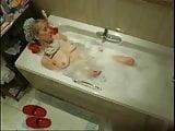 My mum masturbating in bath tube caught by hidden cam
