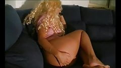 Curly haired blonde farting on her couch