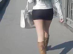 Girl in short skirt in the street