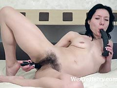 Eva Lisana masturbates with toys in bed