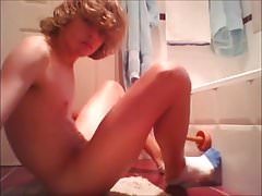 Cute blond teen using toilet brush to fuck his ass