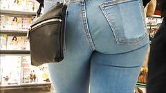 Teen ass in blue jeans very close filmed