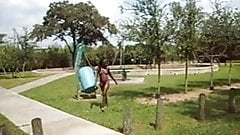 cute black girl walks naked in a small park