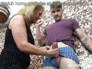 Horny mom sucks stepson's fat cock in the bathroom