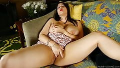 Beautiful busty BBW brunette talks dirty & fucks her pussy