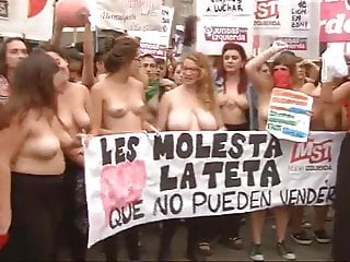 Spanish women protesting topless
