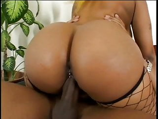 Sexy black babe takes hard cock and a thick facial