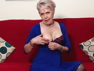 Stylish granny fingering her hungry vagina