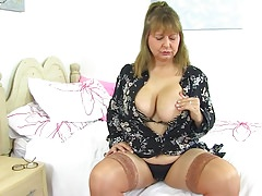 Curvy British mature mother playing with her big tits and