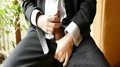 Businessman cums on his suit
