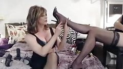 Cougar worships nylon feet of her colleague in bed