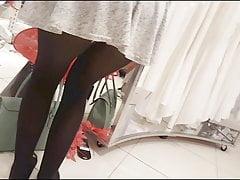 Sexy girl in mini skirt and black pantyhose upskirt