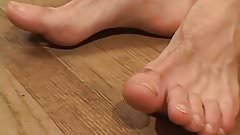 Feet loving twink working on his huge hard dick solo