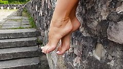 French pedicure and a low wall