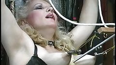 Busty blonde gets her tits used, plays with ropes