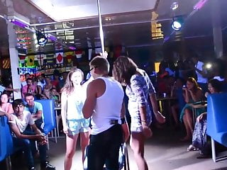 Horny girls give lap dance and grab guys cock