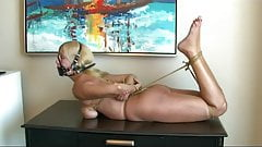 Hogtied barefoot on dresser