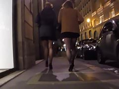 Two brunette in mini skirt tights and high heels