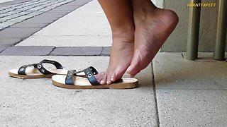 Candid feet of beautician 4