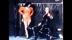 two Divins Mistresses and one stooge in latex