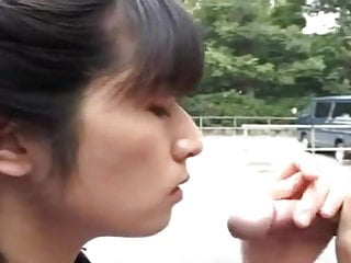 Asian Girl gives head to two guys in public