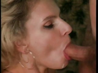 Cute blonde babe sucks on a stiff cock and then fucks