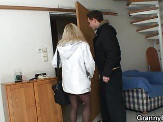 Blonde granny in stockings rides stranger's cock