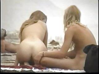 Couple play on the nude beach