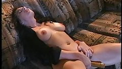Brunette in hot lingerie rams dildo in hot cunt on a couch