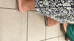 Candid arab hijab feet red pedicure close-up