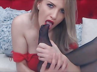 blond in red dress and black stocking lick her nylon feet