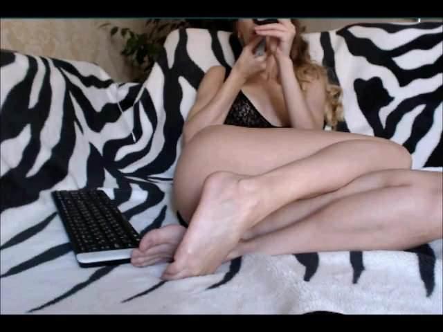 Kinky girl playing with feet