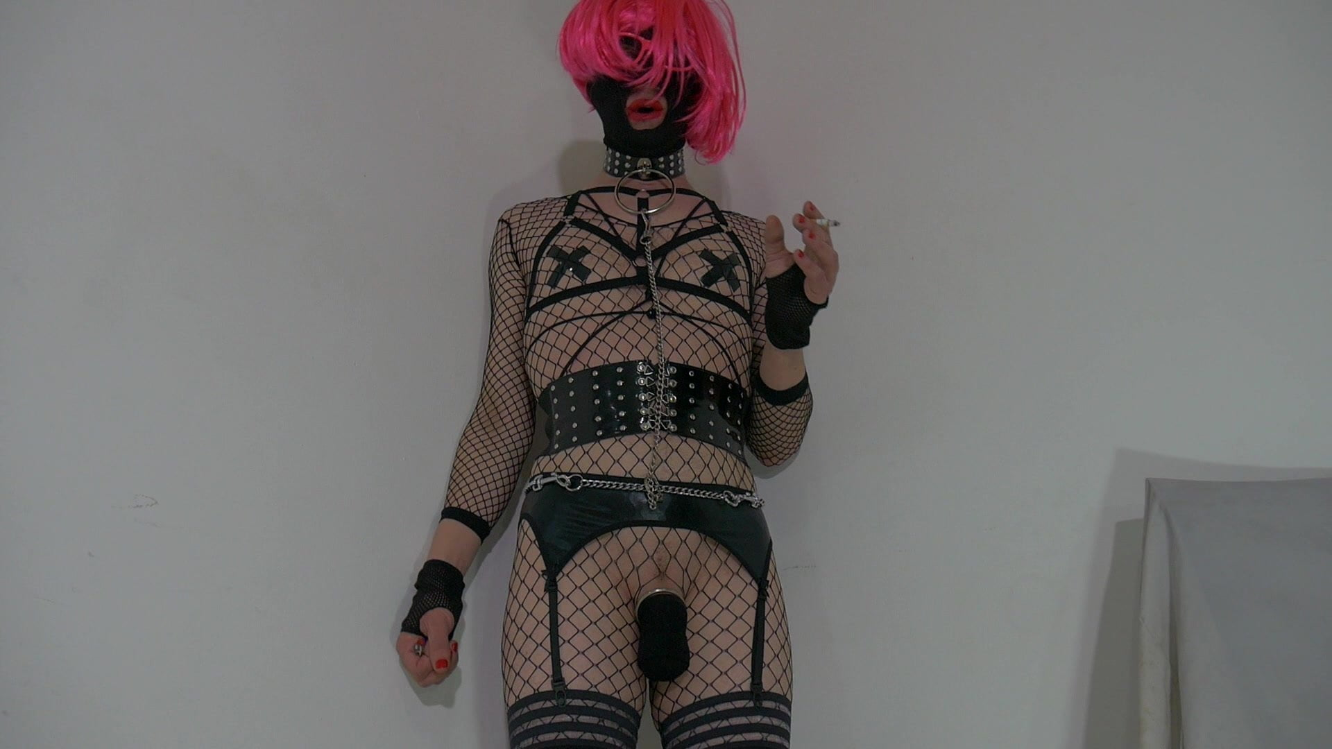 Attractive crossdresser partying at dwelling in slutty outfit