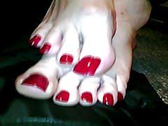 Crossdresser with long polished toenails