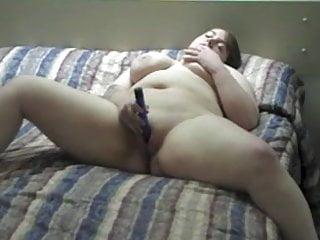 Cute chubby girl masturbates on bed