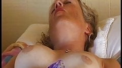 Busty mature playing with herself